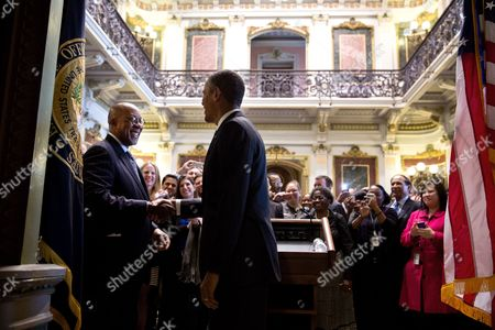 President Barack Obama drops by a farewell reception for U.S. Trade Representative Ron Kirk in the Indian Treaty Room of the Eisenhower Executive Office Building at the White House