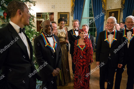 President Barack Obama and First Lady Michele Obama talk with the 2012 Kennedy Center Honorees in the Blue Room of the White House prior to a reception in the East Room. Honorees, from left, are: Chicago bluesman Buddy Guy, Led Zeppelin keyboardist and bassist John Paul Jones, Led Zeppelin singer Robert Plant, ballerina Natalia Makarova, actor Dustin Hoffman, Led Zeppelin guitarist Jimmy Page, and television comedian David Letterman.