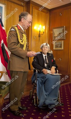 Commander Eddie Grenfell RN (Retd) being presented with his medal by Sir David Richards at Portsmouth Guildhall