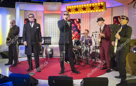 Madness - Lee Thompson, Chas Smash, Suggs, Daniel 'Woody' Woodgate