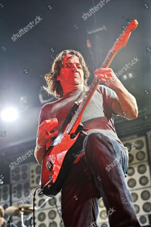 Manchester United Kingdom - June 21: Rhythm Guitarist Stone Gossard Of American Grunge Rock Group Pearl Jam Performing Live On Stage At The Manchester Evening News Arena On June 21