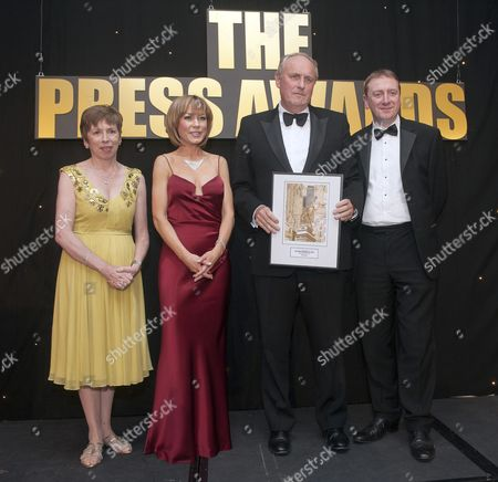 Daily Mail Editor In Chief Paul Dacre Receiving One Of A Several Awards From Bbc Presenter Sian Williams At The U.k. Press Awards In London. 21/03/12 Reporter Eleanor Harding.
