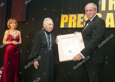 Daily Mail Editor In Chief Paul Dacre Receiving One Of A Several Awards Including 'the Cudlip' Award For The Stephen Lawrence Campaign At The U.k. Press Awards In London. Newsreader Sian Williams (left) 21/03/12 Reporter Eleanor Harding.