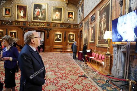 Robert Hardy looks at a display