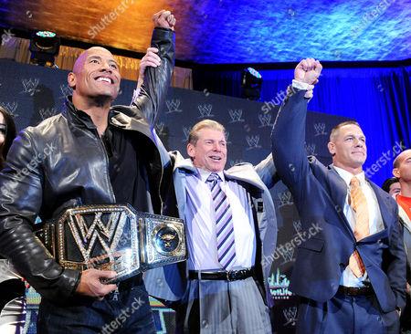 Dwayne Johnson and John Cena and Vince McMahon