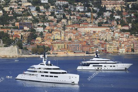 Vava II, a cruiser built by Pendennis Plus, formerly Devenport Yachts, length: 96 m, built in 2012, owned by Ernesto Bertarelli, and the Hermitage, a cruiser built by Luerssen Yachts, length: 68.15 m, built in 2011, anchored in the Bay of Villefranche, French Riviera, France, Mediterranean Sea