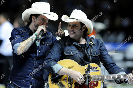 Singer Boss Burns alias Alec Voelkel, left, and guitarist Hoss Power aka Sascha Vollmer of the The BossHoss band, performing at the qualifying match for the FIFA World Cup 2014, Germany - Sweden 4:4, Olympic Stadium, Berlin, Germany