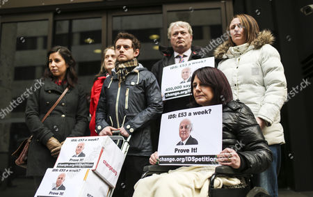 Stock Photo of A petition calling for Iain Duncan Smith to live on £53 for a week being handed into the Department of Work and Pensions by Dominic Aversano (C) who started the campaign, together with Lucia Molina, Eileen Short, Ian Mortimer Jones, Zoe Simpson and Heather Simpson (in wheelchair)