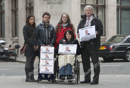 A petition calling for Iain Duncan Smith to live on £53 for a week being handed into the Department of Work and Pensions by Dominic Aversano (C) who started the campaign, together with Lucia Molina, Eileen Short, Ian Mortimer Jones, Heather Simpson (in wheelchair)