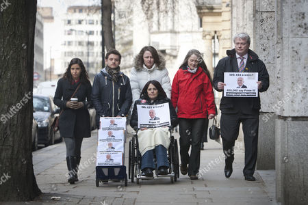 Stock Picture of A petition calling for Iain Duncan Smith to live on £53 for a week being handed into the Department of Work and Pensions by Dominic Aversano (C) who started the campaign, together with Lucia Molina, Eileen Short, Ian Mortimer Jones, Zoe Simpson and Heather Simpson (in wheelchair)