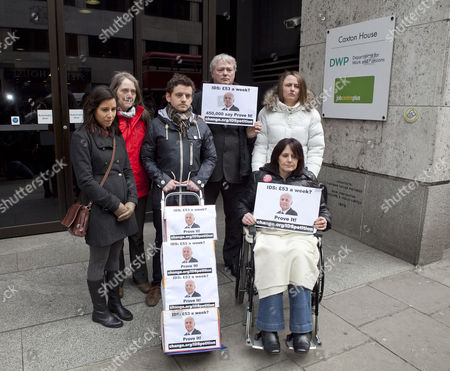 Stock Image of A petition calling for Iain Duncan Smith to live on £53 for a week being handed into the Department of Work and Pensions by Dominic Aversano (C) who started the campaign, together with Lucia Molina, Eileen Short, Ian Mortimer Jones, Zoe Simpson and Heather Simpson (in wheelchair)