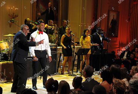 "Sam Moore (left) and Joshua Ledet perform ""Soul Man"" for United States President Barack Obama (front row center)"
