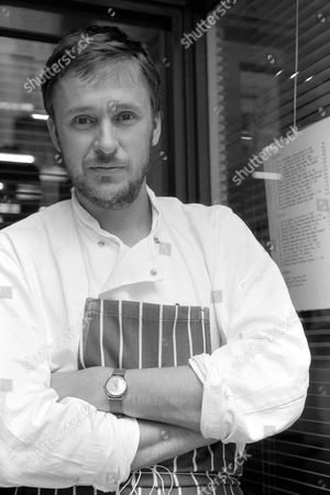 Stock Photo of Alastair Little, chef, standing outside his restaurant in Frith Street, Soho, London.