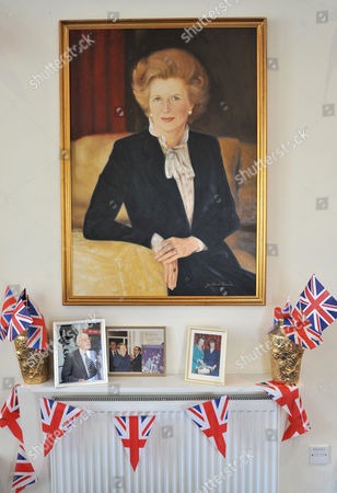 A painting depicting the late Prime Minister Margaret Thatcher hangs from the wall, alongside photographs of her with husband Denis Thatcher, at the Conservative Party headquarters in Finchley