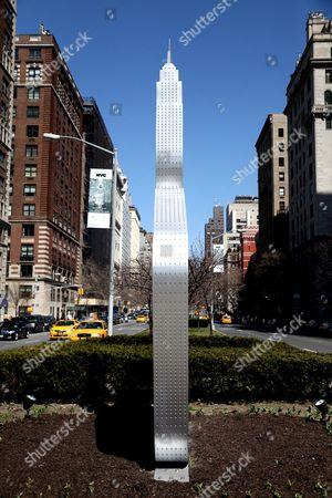 Stock Picture of Alexandre Arrechea 'No Limits' sculpture installation on Park Avenue, Manhattan, New York, America - Empire State Building