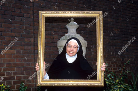 Sister Wendy Beckett holding picture frame