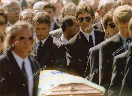 British racing drivers Damon Hill and Derek Warwick help carry Ayrton Senna's coffin to his grave.