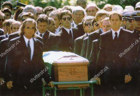 Stock Image of Racing drivers Emerson Fittipaldi, Alain Prost, Sir Jackie Stewart, Johnny Herbert, Johnny Herbert, Derek Warwick, Damon Hill and Gerhard Berger escort Ayrton Senna's coffin to his grave.