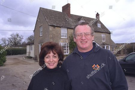 George Dailey And Wife Cargie Of The Boot Inn Near Witney Oxon Who Own A Celebrity Footware Collection Including Amongst Others; Michael Hesletine (blue Flipper) Sam Torrance (golf Shoe) Janet Street Porter Nigel Davenport Laura Davies Tim Henman Sarah Kennedy Jeremy Clarkson ( Hole In Boot).