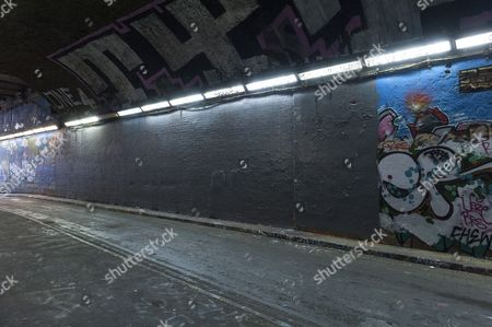 Anti Margaret Thatcher graffiti cover-up over with grey paint.