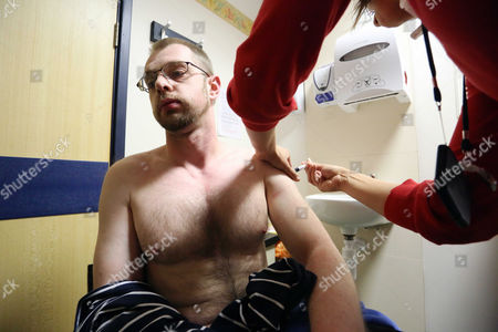 35-year-old Simon Jenkins receives the MMR vaccination at the Princess of Wales Hospital in Bridgend