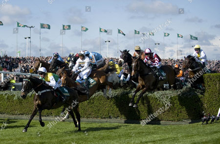 Apr 12th 2012 - Liverpool UK. Aintree Festival Grand National - Cloudy Lane Ridden By Richard Harding Jumps The Water Jump In The Fox Hunters Steeple Chase At Aintree.
