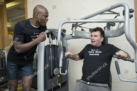 Big Brother Winner Brian Belo Spurs On Traveller Paddy Doherty To Push Some Big Weights At The 'no Carbs Before Marbs' Fitness Bootcamp At The Crowne Plaza Spa In Colchester.