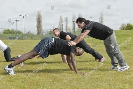 Big Brother Winner Brian Belo And Traveller Paddy Doherty Do Some Pushups At The 'no Carbs Before Marbs' Fitness Bootcamp At The Crowne Plaza Spa In Colchester.