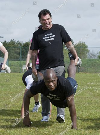 Big Brother Winner Brian Belo And Traveller Paddy Doherty Power Into The Lead On The Wheelbarrow Race At The 'no Carbs Before Marbs' Fitness Bootcamp At The Crowne Plaza Spa In Colchester.