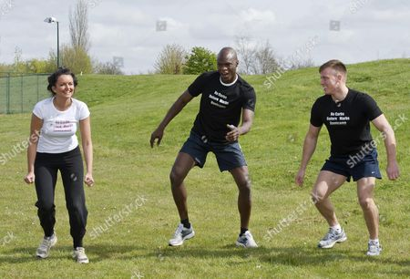 The Group On The 'no Carbs Before Marbs' Fitness Bootcamp At The Crowne Plaza Spa In Colchester Do A Warm Up Session. Pictured Towie Girl Ellli Redman (left) And Bb Winner Brian Belo. Als.