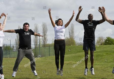 Stock Picture of The Group On The 'no Carbs Before Marbs' Fitness Bootcamp At The Crowne Plaza Spa In Colchester Do A Warm Up Session. Pictured Traveller Paddy Doherty (left) Towie Girl Ellli Redman (centre) And Bb Winner Brian Belo.
