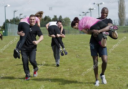Stock Photo of Bb Winner Brian Belo Tries The Fireman's Lift Race At The 'no Carbs Before Marbs' Fitness Bootcamp At The Crowne Plaza Spa In Colchester.