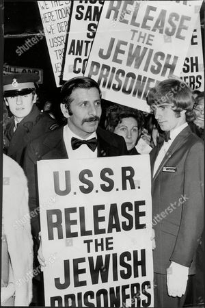 Actor Topol With Protest Board At Film Premiere Of His Film 'fiddler On The Roof' Chaim Topol (born September 9 1935) Often Billed Simply As Topol Is An Israeli Theatrical And Film Performer Actor Writer And Producer. He Has Been Nominated For An Oscar And Tony Award And Has Won Two Golden Globes.