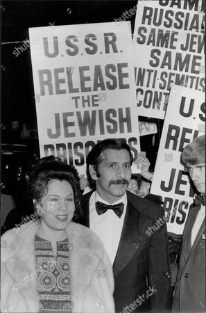 Actor Topol With Wife Galia Amongst The Protest Boards At Film Premiere Of His Film 'fiddler On The Roof' Chaim Topol (born September 9 1935) Often Billed Simply As Topol Is An Israeli Theatrical And Film Performer Actor Writer And Producer. He Has Been Nominated For An Oscar And Tony Award And Has Won Two Golden Globes.