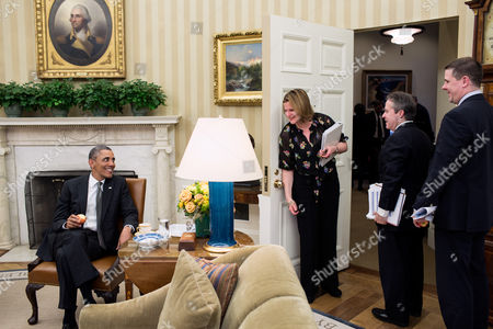 Stock Image of President Barack Obama talks with Director of Communications Jennifer Palmieri, National Economic Council Director Gene B Sperling, and Senior Advisor Dan Pfeiffer following a meeting in the Oval Office