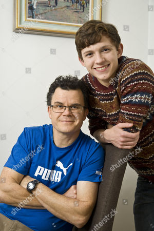 Actor Tom Holland with his father comedian and writer Dominic Holland. At home Norbiton, Surrey.