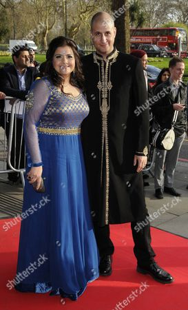 Stock Photo of Nina Wadia and husband Raiomond Mirza