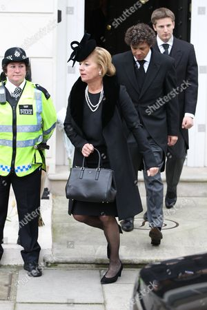 Carol Thatcher leaves her mother Margaret Thatcher's home with Marco Grass and Michael Thatcher