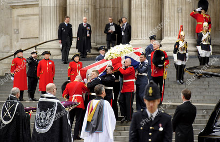 The coffin of Baroness Margaret Thatcher is carried to the bottom of the St Paul's Cathedral steps