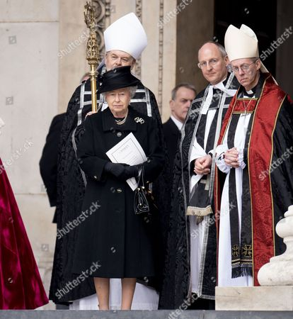 Queen Elizabeth II, The Very Reverend David Ison and Justin Welby Archbishop Of Canterbury, outside St Paul's Cathedral after the service