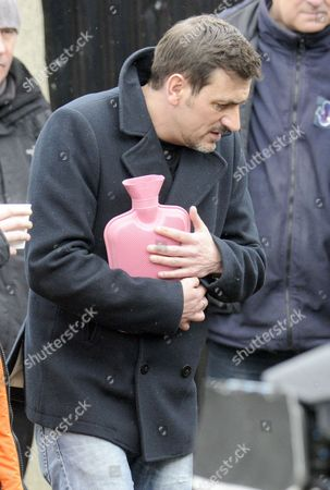 Chris Gascoigne with a hot water bottle