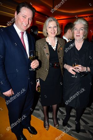 Stock Photo of Theresa May and Marjorie Scardino and guest