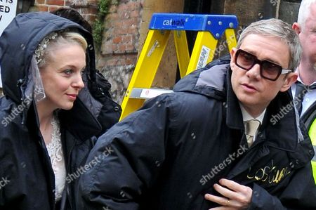 The bride and groom emerge - Amanda Abbington (Mary Morstan) and Martin Freeman (John Watson)