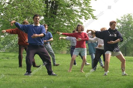 Mark Sheppard Photographed With His Tai Chi Class In Hyde Park. Writer Sonia Ducie (wearing A Red Top).