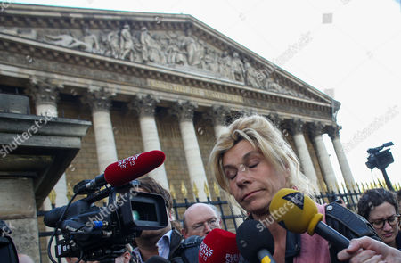 Activist Frigide Barjot of the anti-gay marriage movement 'la Manif pour Tous' protests during a demonstration, a few hours after the French Parliament adopted a gay marriage law