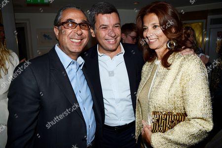 Stock Photo of Nasser Khalili, guest and Marion Easton (wife of Nasser Khalili)