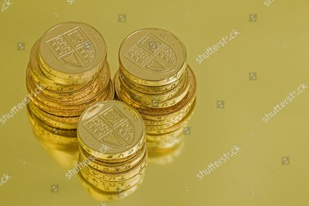 One pound and two pound coins in three stacks