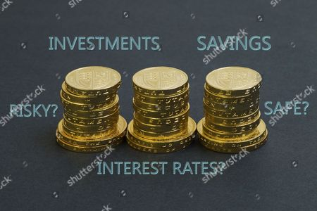 Three stacks of one pound and two pound coins with words: Investments, Savings, Interest Rates, etc.