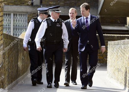 Nick Clegg with Jeremy Browne, Minister for Crime Prevention, and local police officers