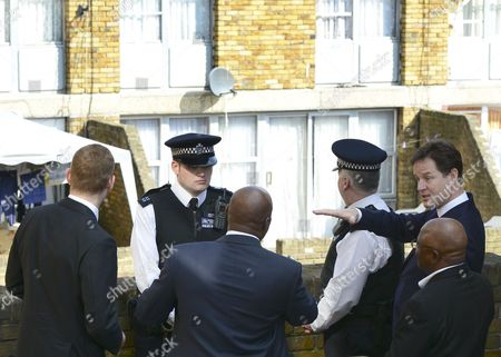 Nick Clegg with Jeremy Browne, Minister for Crime Prevention, local police officers and community workers